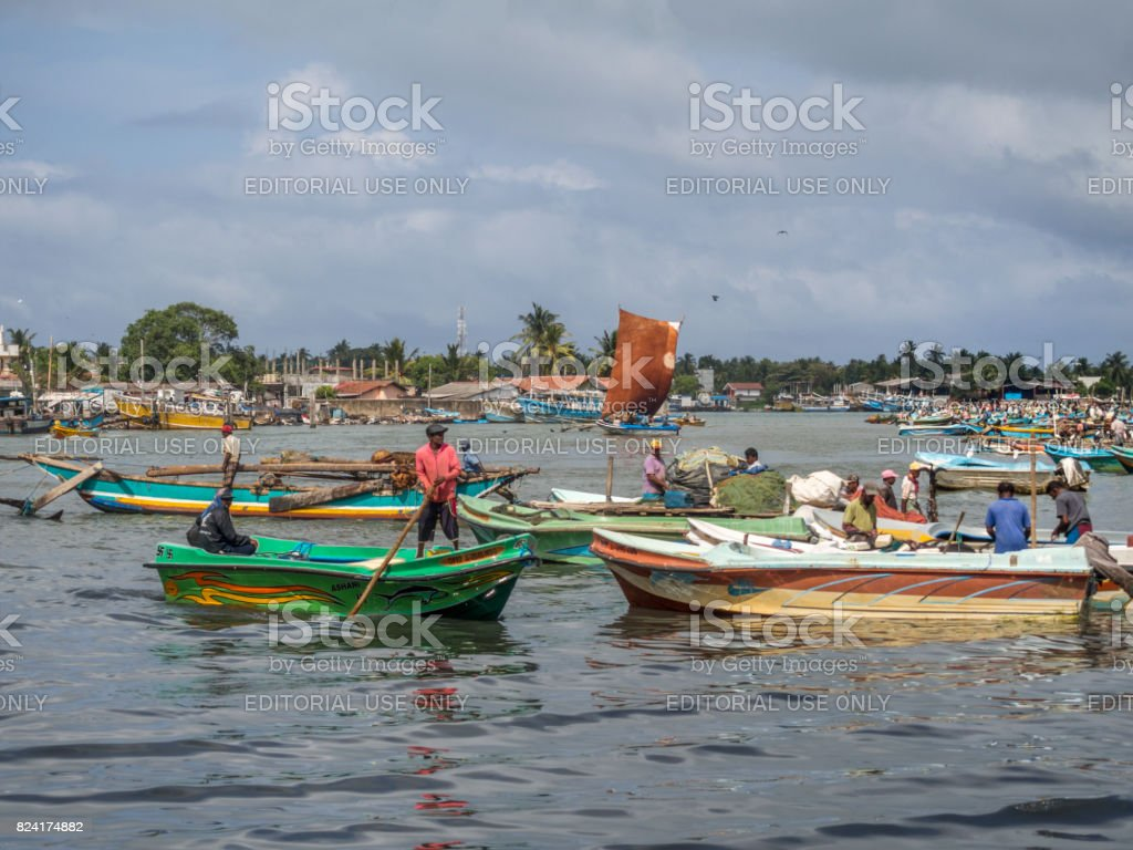 Old Oruvas sail boat coming into Negombo harbor. This image is GPS tagged stock photo