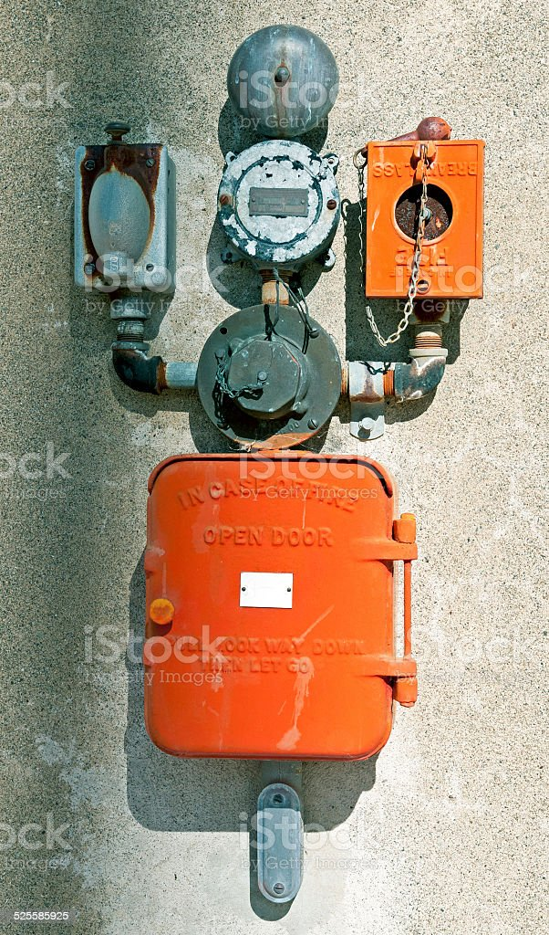 Old outdated fire alarm equipment on building stock photo