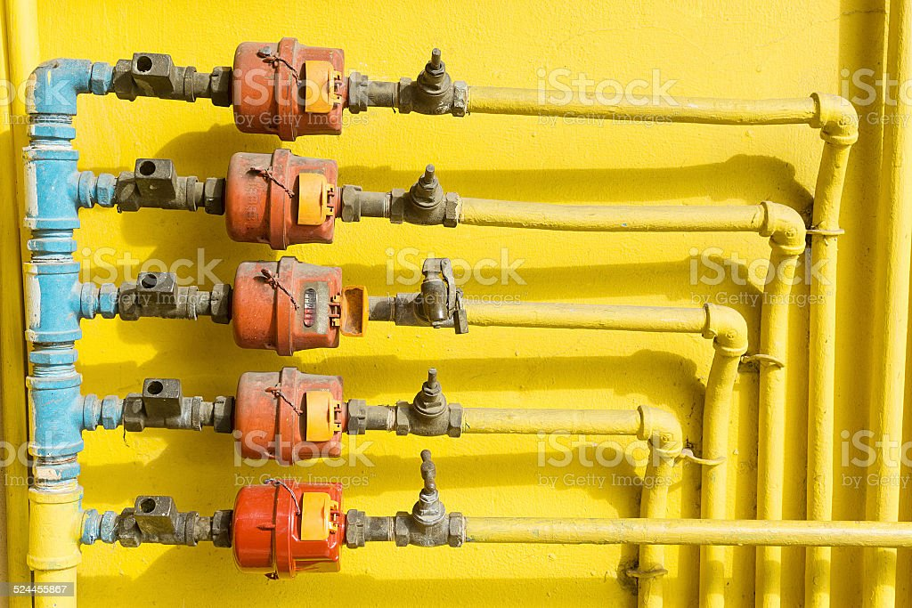 Old outdoor home water valve and water meter stock photo