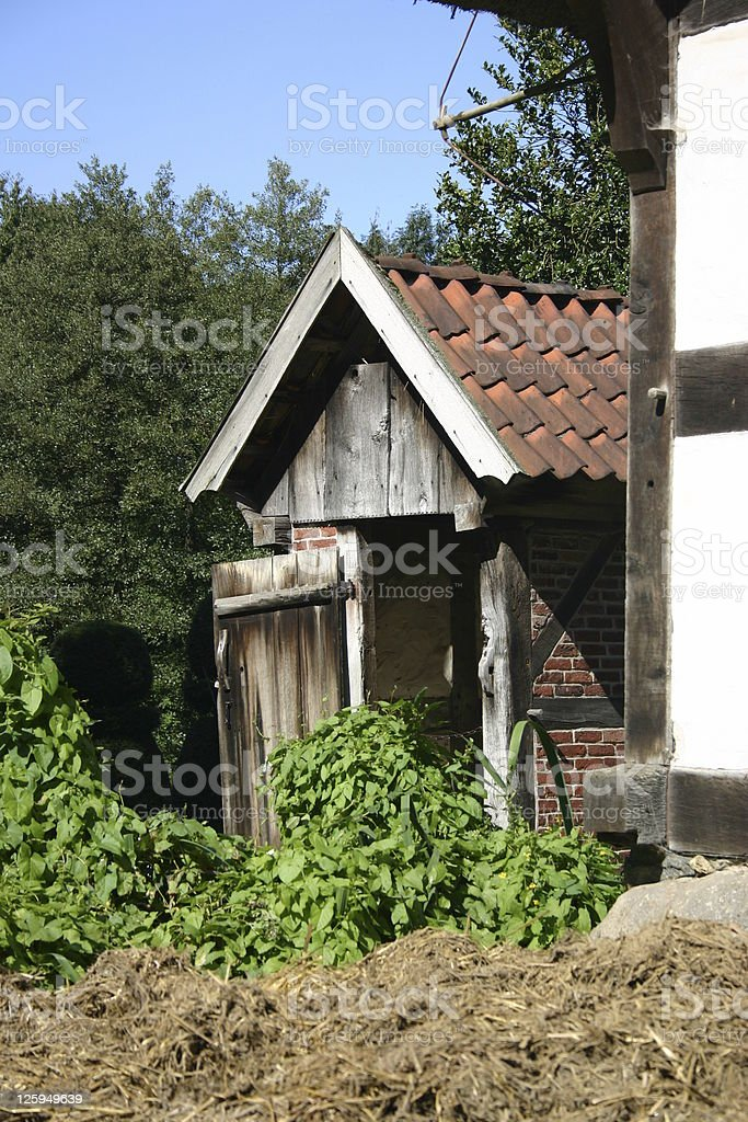 Old outhouse with a bunch of crap stock photo