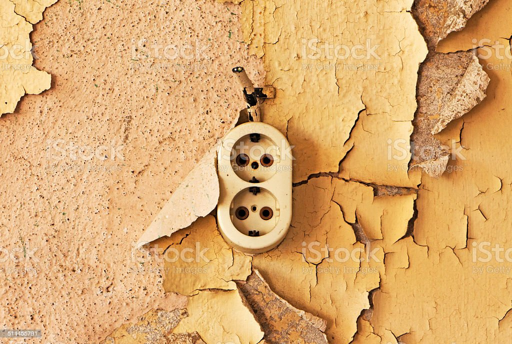 Old  outlet and cable on a decrepit wall stock photo