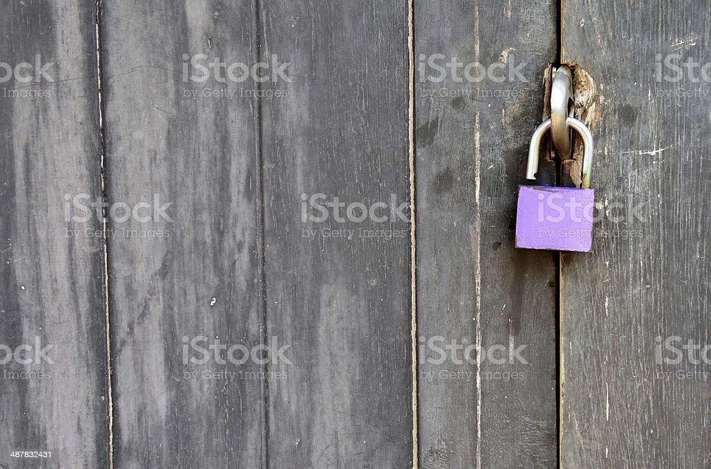 Old padlock on a wooden door stock photo