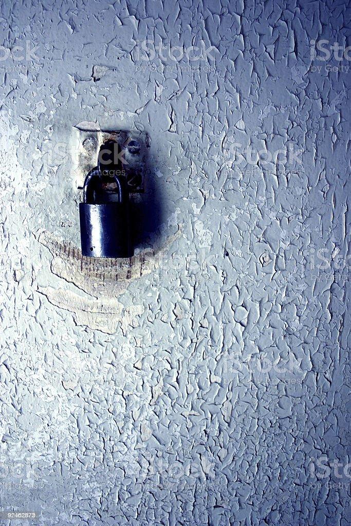 Old padlock on peeling paint stock photo