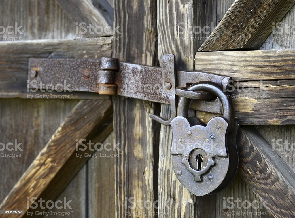 Old padlock - side view royalty-free stock photo