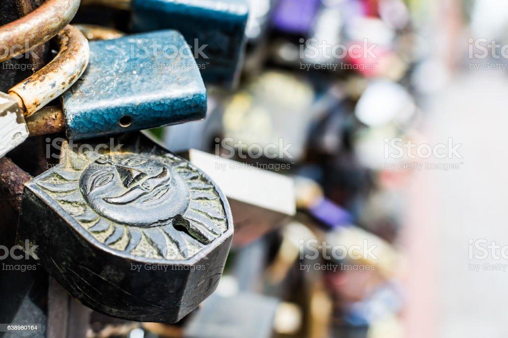 Old padlock with sun symbol. stock photo