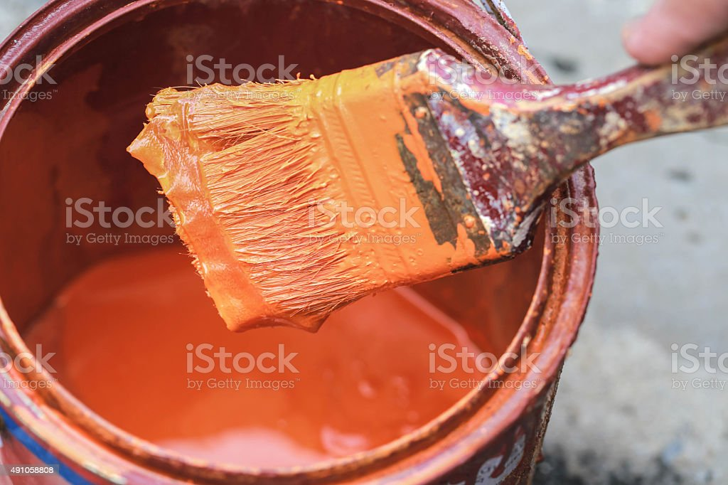 Old paint brush tool in the over the can. stock photo