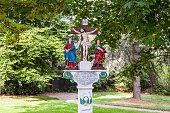 old painted crucifix to remember a dead priest near Trittenheim,