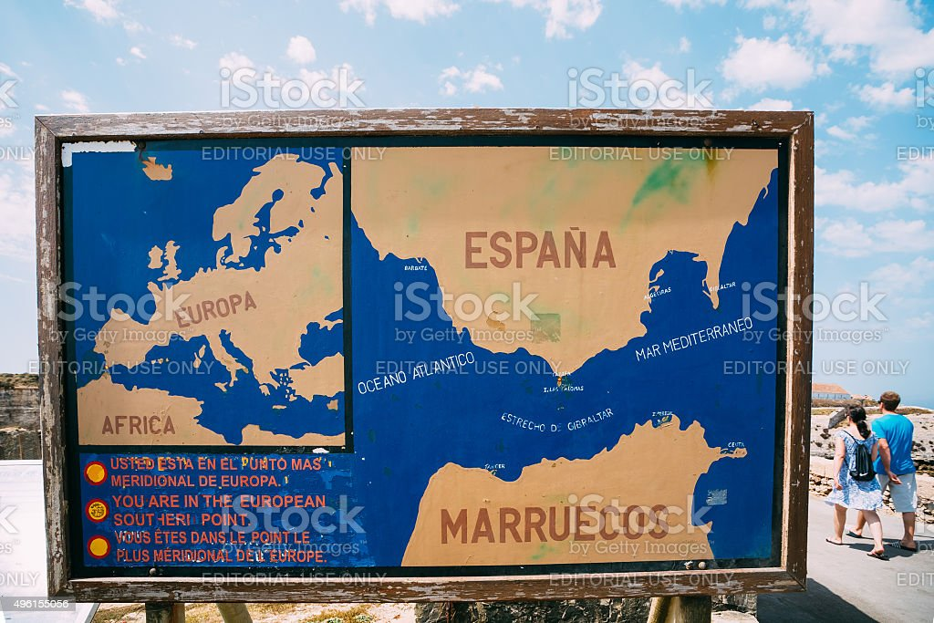 Old painted Information board on the beach stock photo
