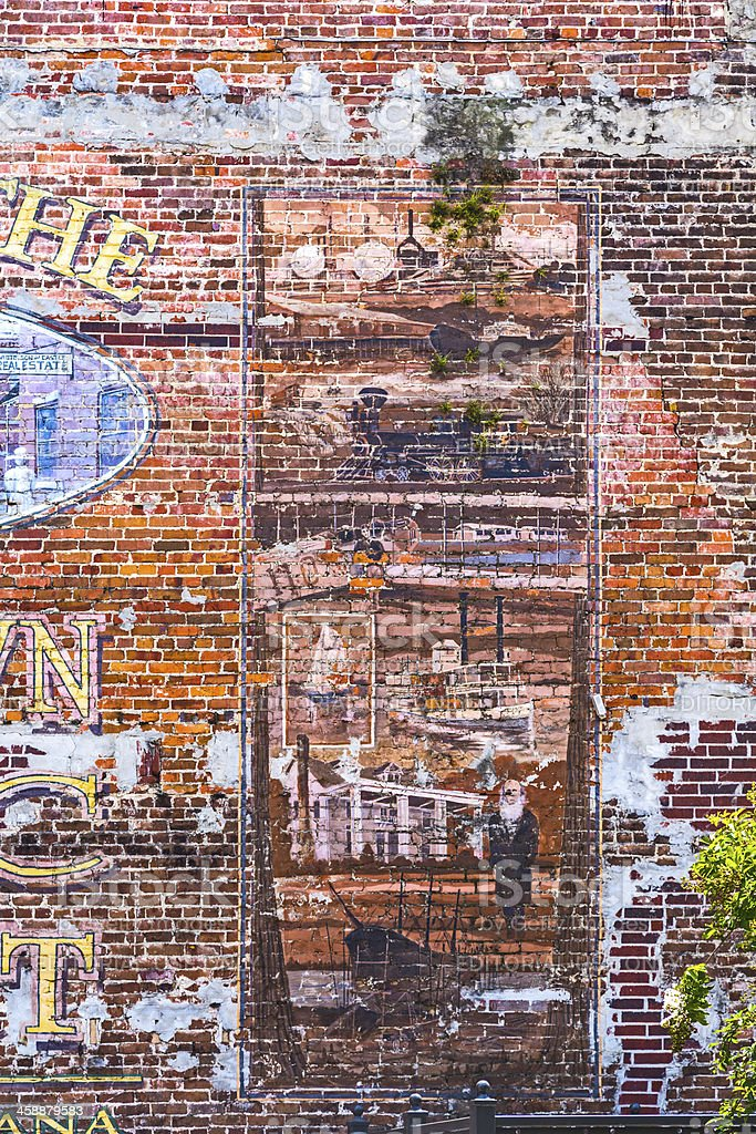old painted pictures at the brick wall stock photo