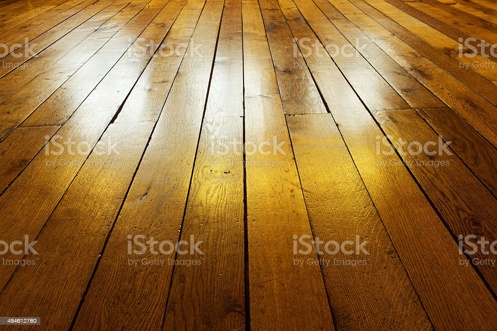Old painted wooden floor in backlight stock photo