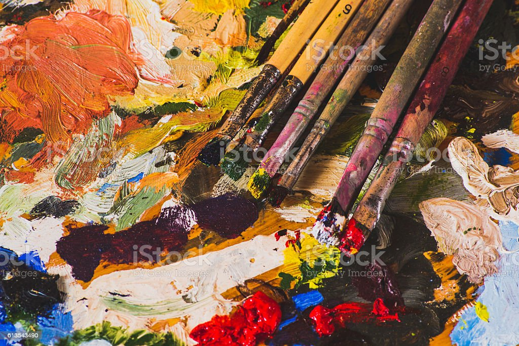 Old palette and brushes stock photo