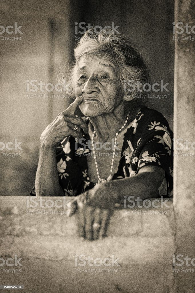 Old Panamanian woman in her jungle coffee farmhouse stock photo