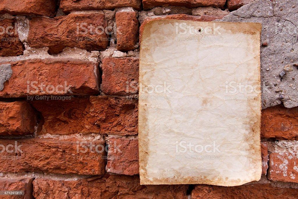 Old paper and brick wall herizontal royalty-free stock photo