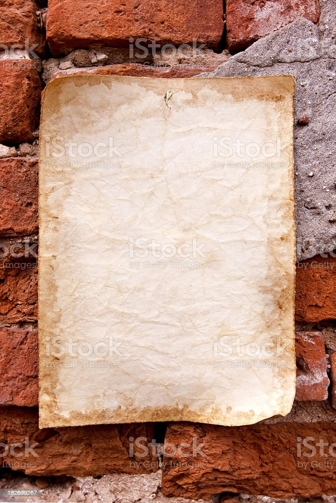 Old paper and brick wall stock photo