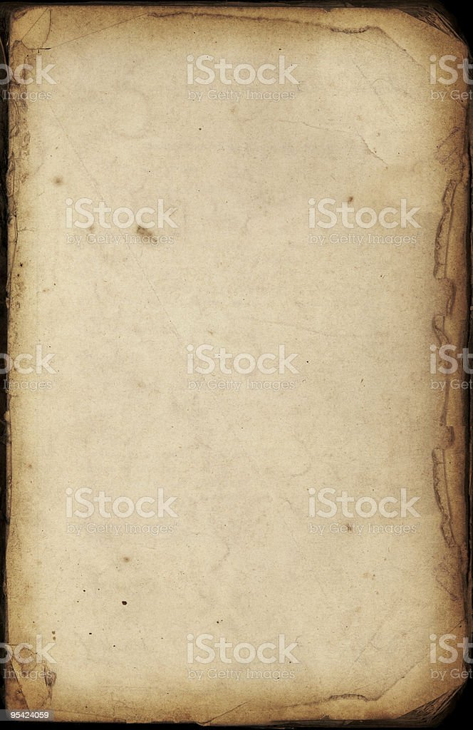 Old paper in book with torn edges royalty-free stock photo