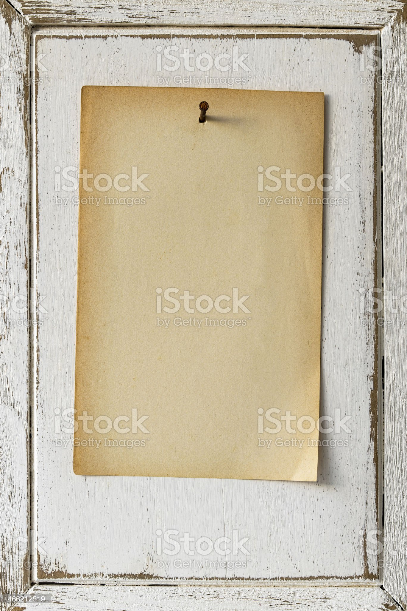 Old paper nailed to a weathered wooden notice board. royalty-free stock photo