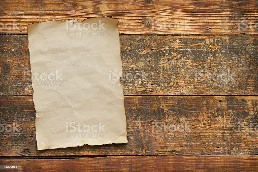 old paper nailed to a wooden door royalty-free stock photo