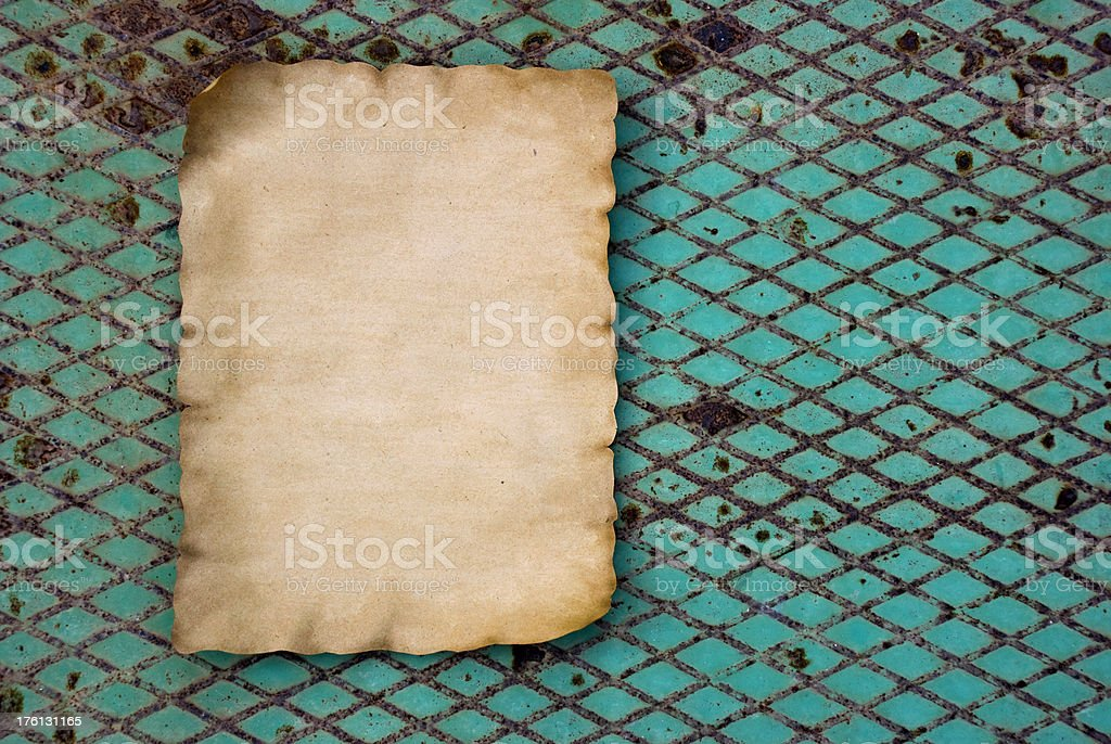 Old paper on a rusty metal stock photo