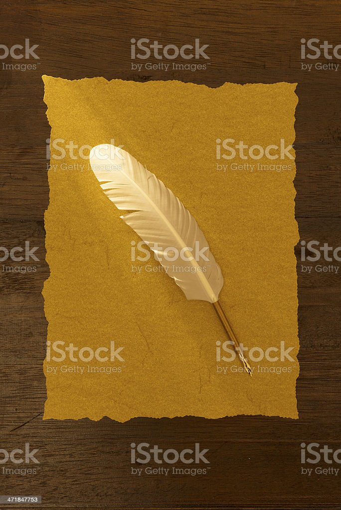 Old paper on desk with quill pen royalty-free stock photo