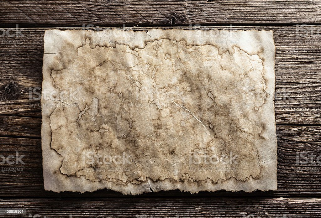 old paper on wood background stock photo