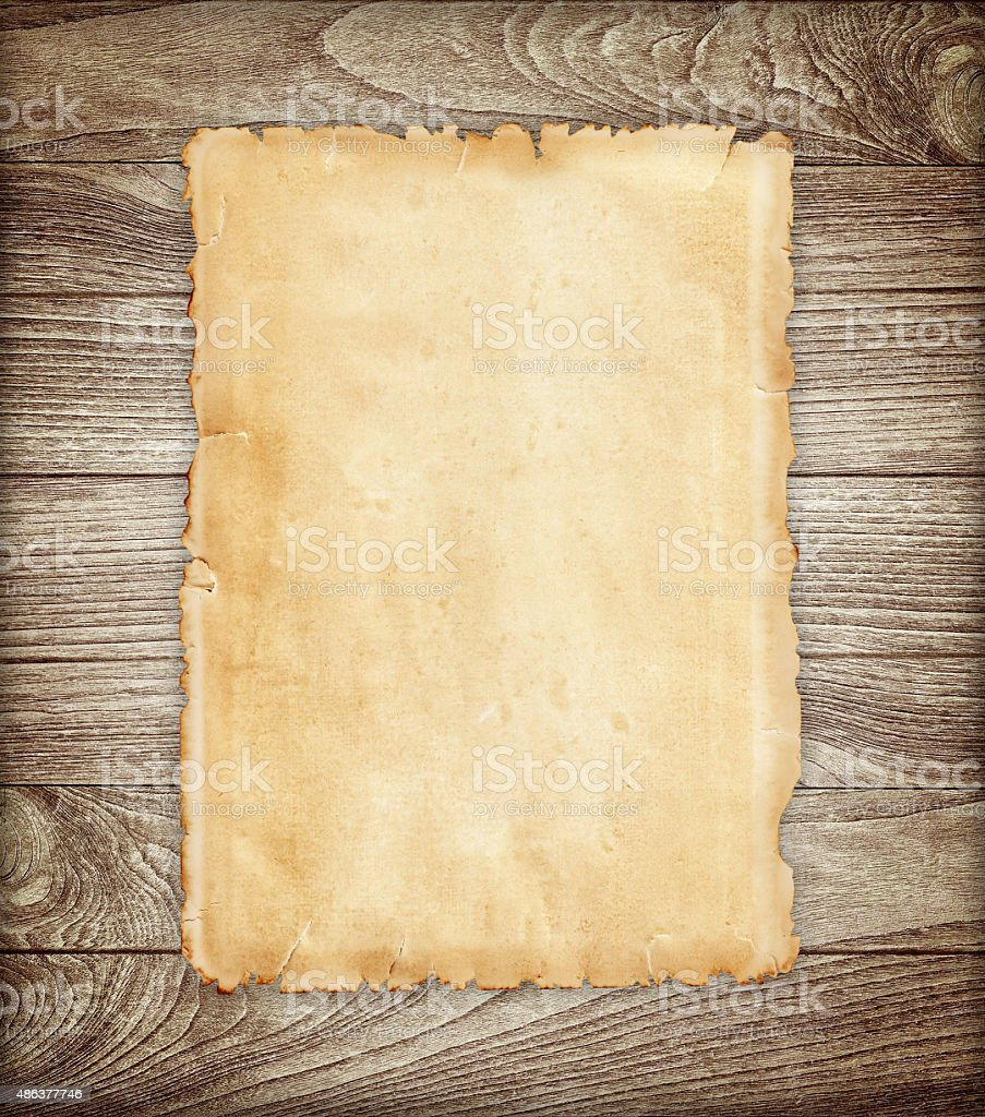 Old paper on wood background. stock photo