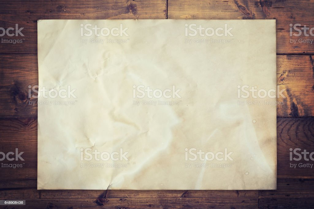 Old paper on wood background vintage with space stock photo