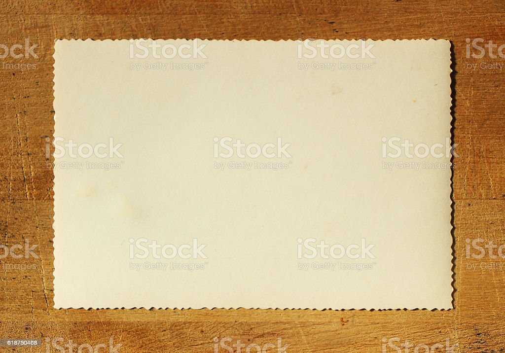 Old Paper on Wood Table (including clipping path) stock photo