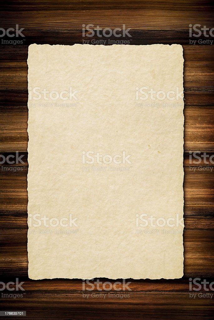 Old paper on wooden board royalty-free stock photo