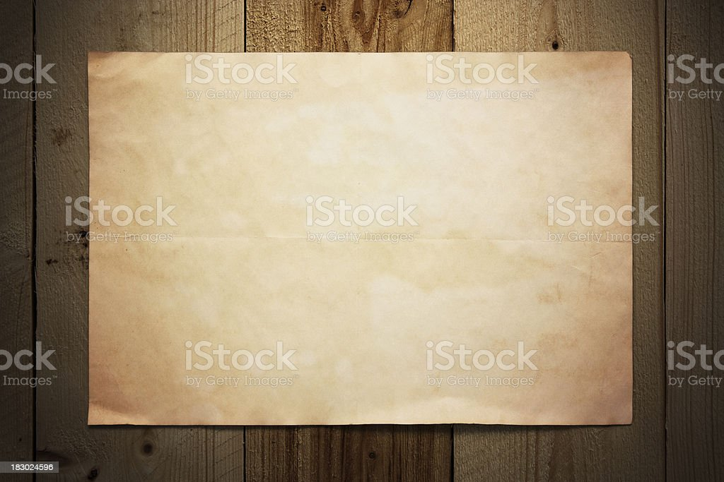 Old paper on wooden wall stock photo