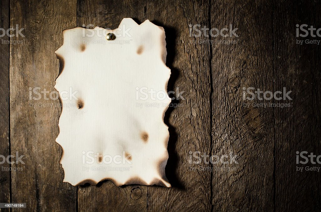 Old paper over wooden background stock photo