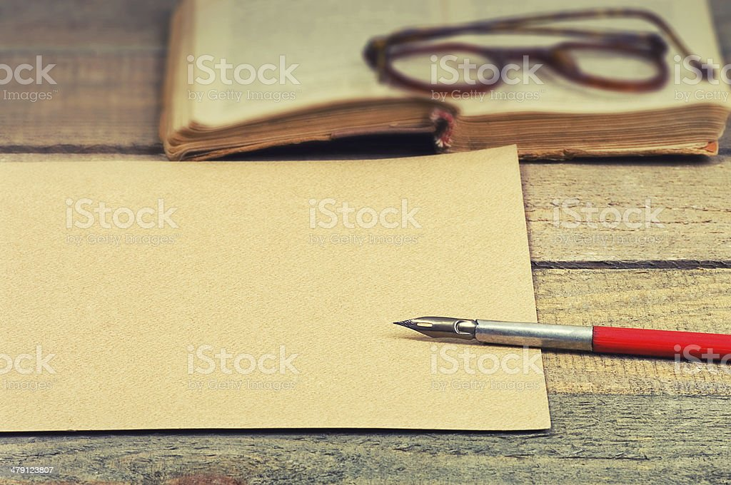 old paper, pen, book and glasses stock photo