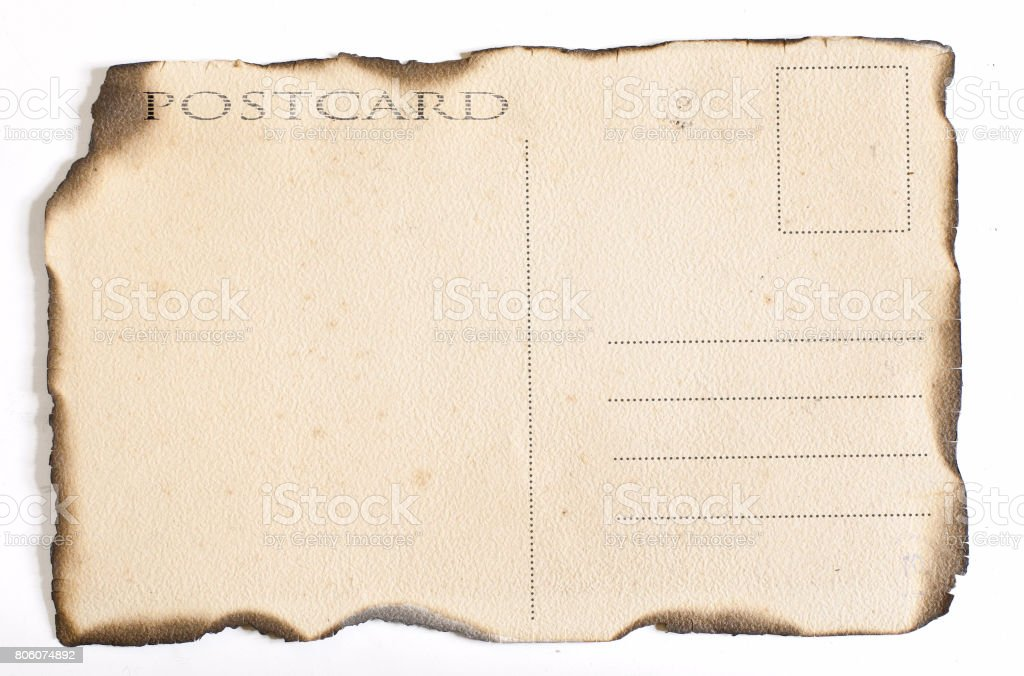 old paper postcard with charred edges stock photo