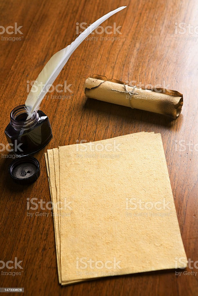 Old paper, quill pen and scrol on wooden table stock photo