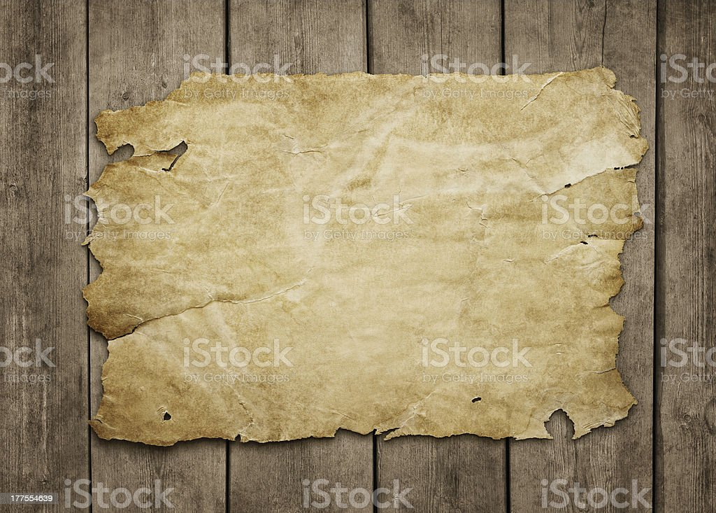 Old paper sheet at wooden background stock photo