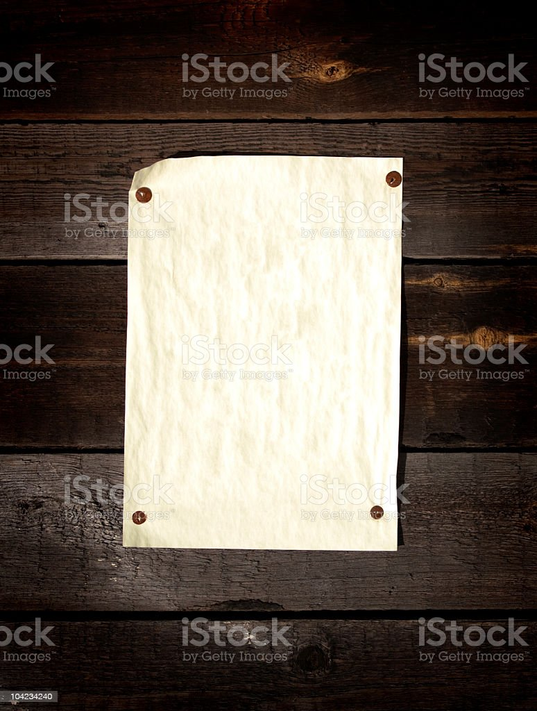 Old paper tacked to a wood wall royalty-free stock photo