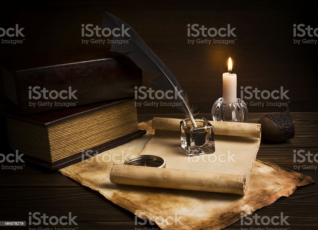 old papers and books on a wooden table stock photo
