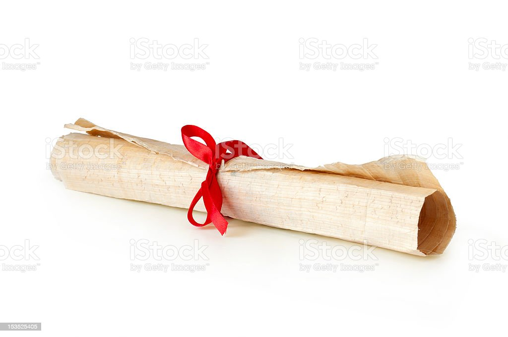 old papyrus scroll in roll with ribbon royalty-free stock photo