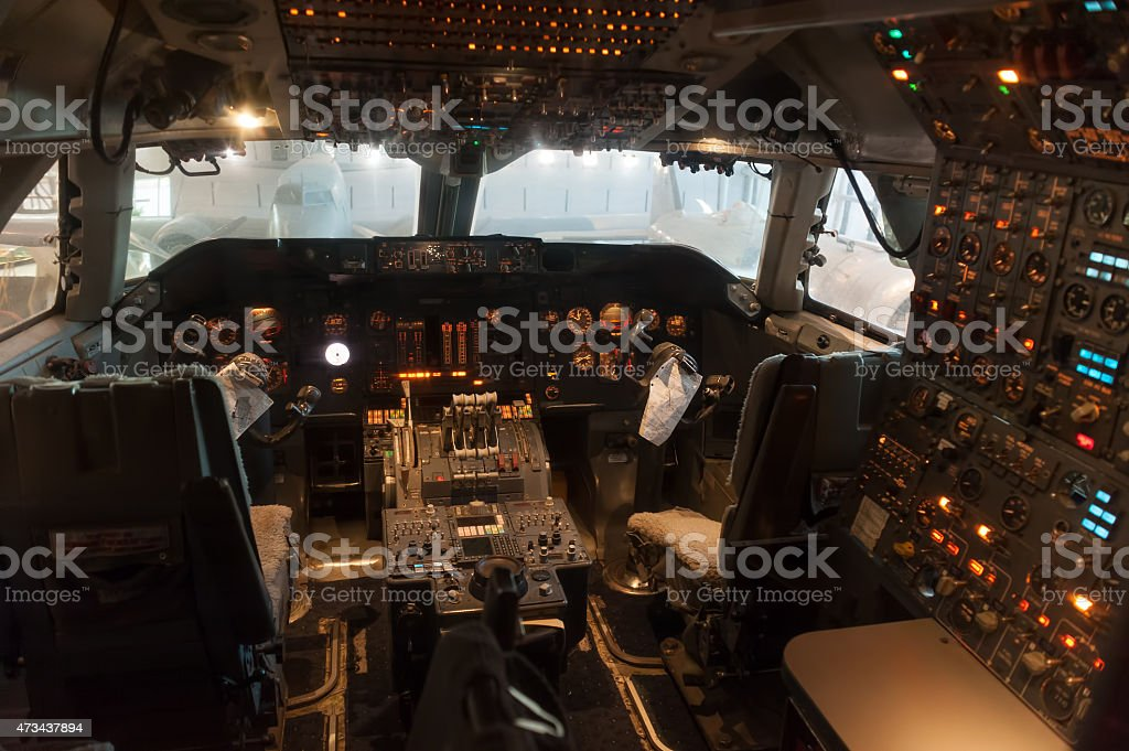 Old passenger airplane cockpit, plane interier stock photo