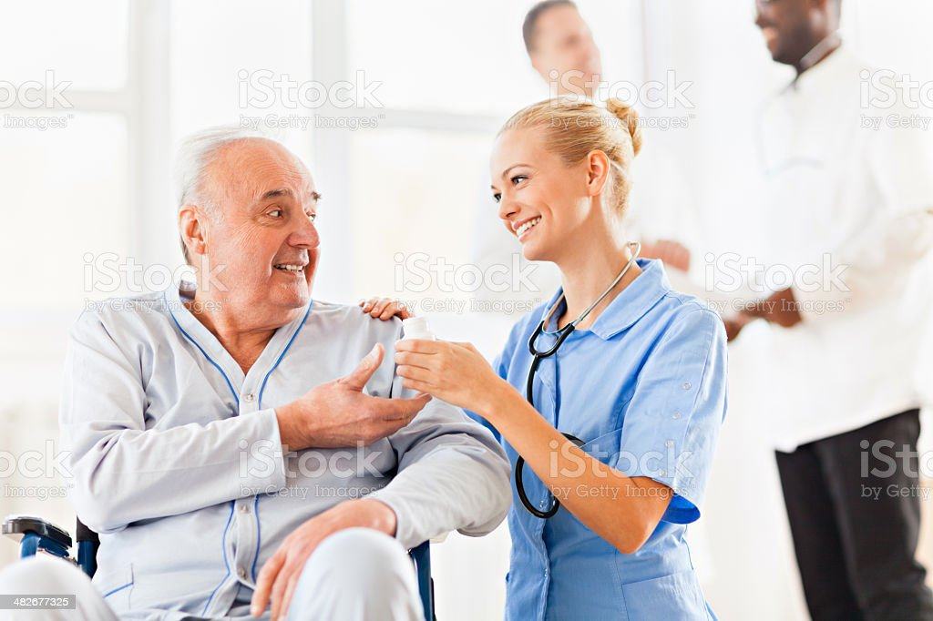 Old patient with doctor royalty-free stock photo