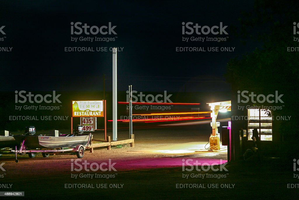old patrol station by night stock photo