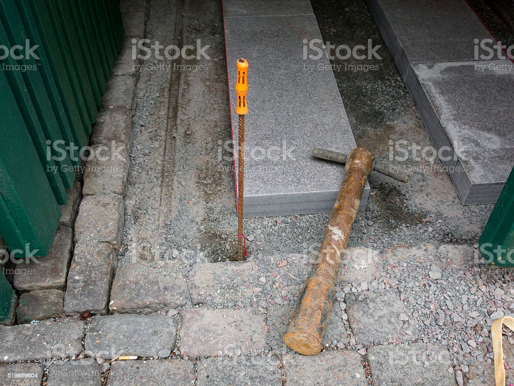 Old paving hammer on worksite stock photo