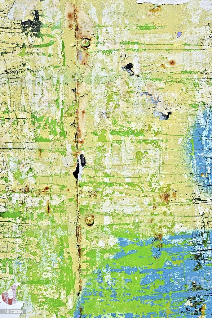 Old peeling paint grunge background / Torn poster royalty-free stock photo