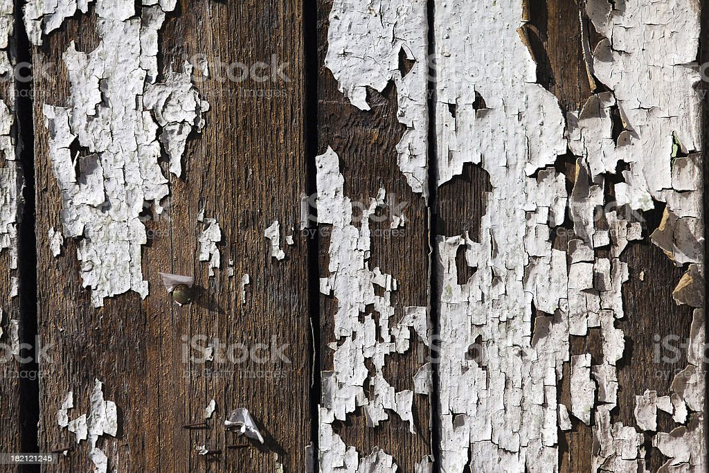 Old peeling paint on the wooden wall royalty-free stock photo
