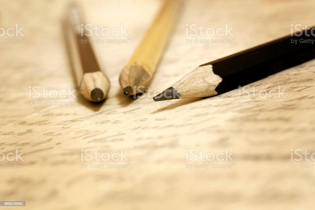 Old pencils and letter stock photo