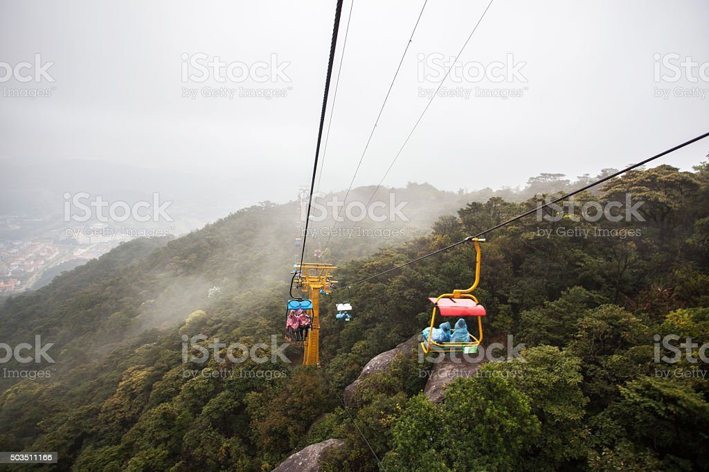 Old People sit in open cable car stock photo