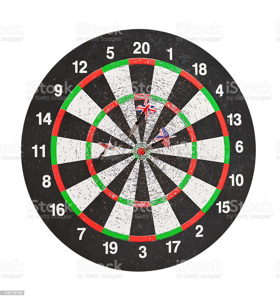 old perforation dartboard with flags on darts stock photo