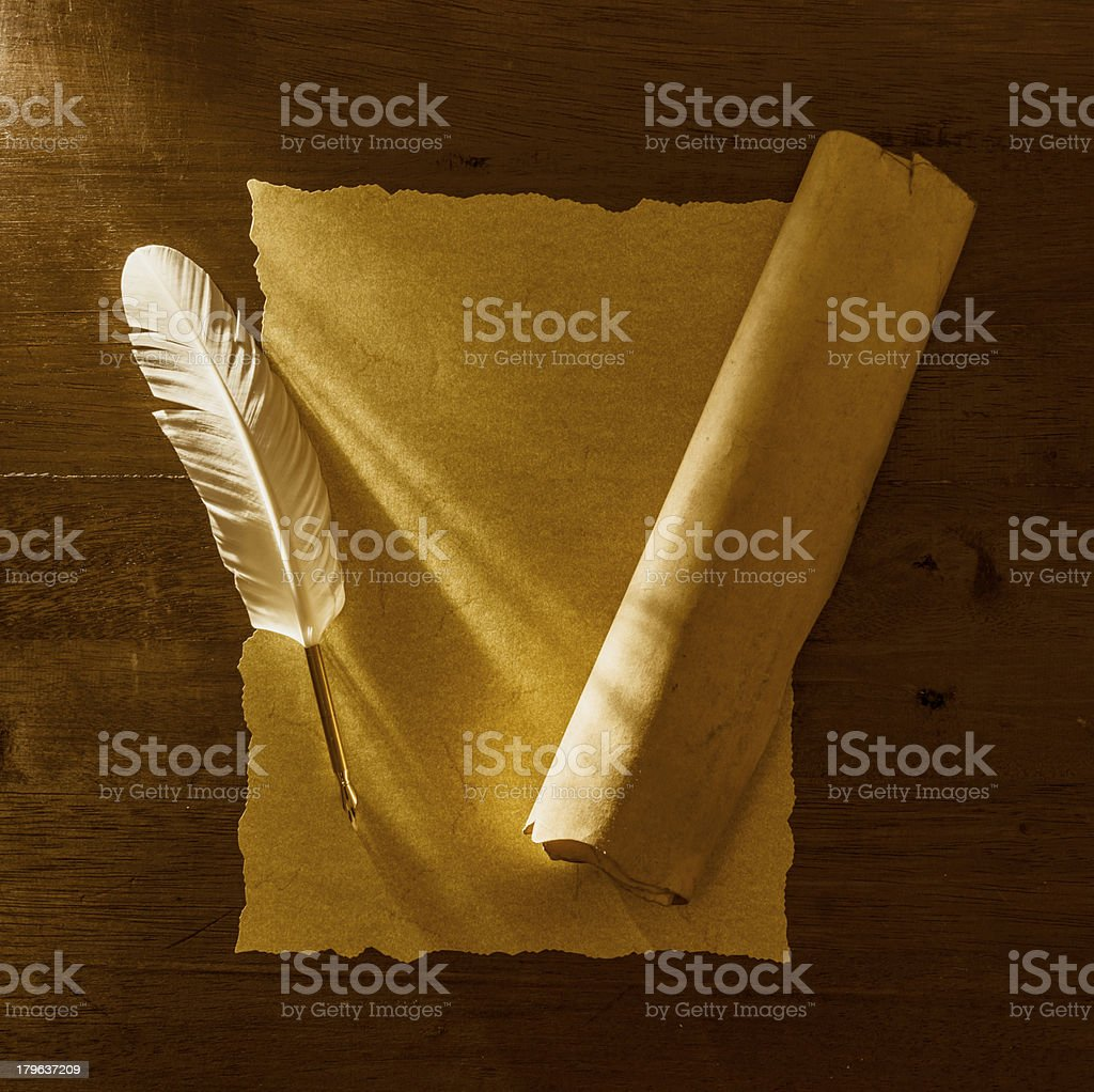 Old pergamin on letter with quill pen royalty-free stock photo