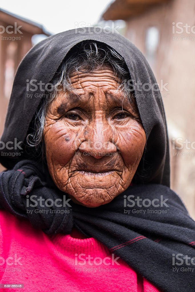 Old Peruvian Woman in Traditional Clothes stock photo