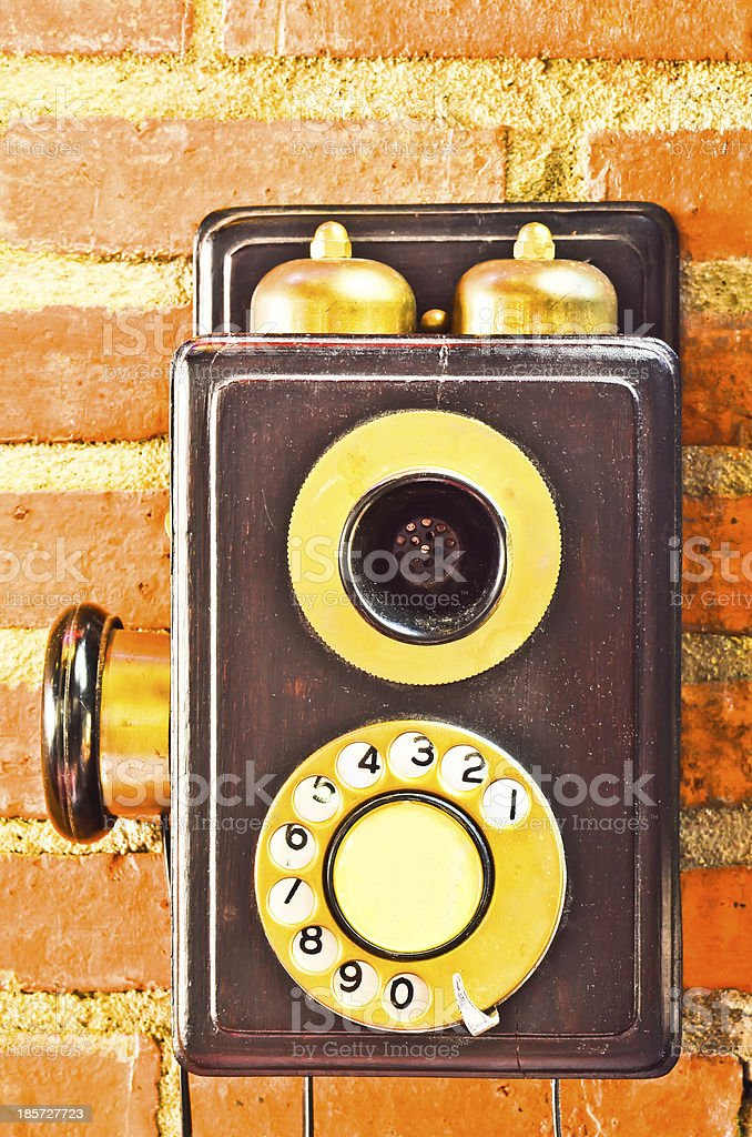 Old phone on the wall royalty-free stock photo