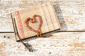 Old photo album with amber necklace heart